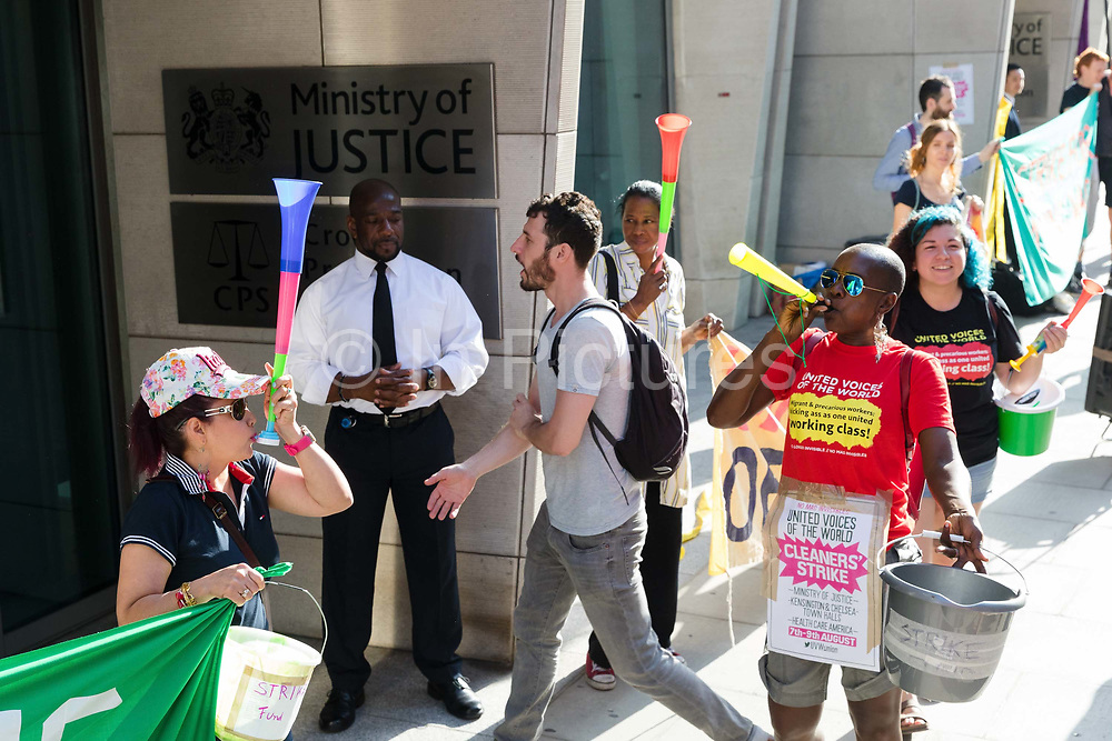 Striking cleaners from the union, United Voices of the World stage a picket protest outside the Ministry of Justice Headquarters in London, England on August 07, 2018. The cleaners strike is taking place over a three day period and covers cleaners working under the Amey, OCS and Compas contracts at three Ministry of Justice sites, large hospitals, and Kensington and Chelsea Town Halls, where the cleaners are demanding better pay and employment rights, including sick pay, living wage and equality with directly employed staff.