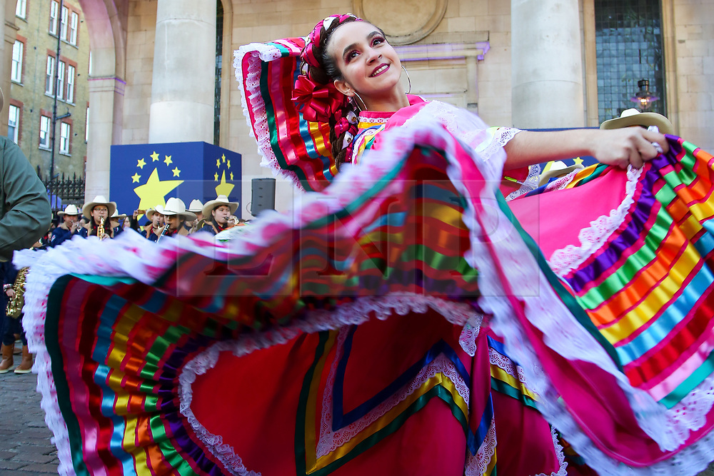 © Licensed to London News Pictures. 30/12/2019. London, UK. A performer from Carnaval del Pueble performs at the preview of the London New Year's Day Parade inCovent Garden Piazza.<br /> The London New Years Day Parade, in its 32nd year will take place on 1 January 2020 and will feature more than 10,000 performers from across the world. Photo credit: Dinendra Haria/LNP