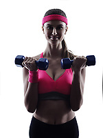 one woman fitness weights training  exercises  in studio silhouette isolated on white background