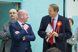 © Licensed to London News Pictures . 09/10/2014 . Heywood , UK . Paul Nuttall MEP of UKIP and Tobe Perkins MP of Labour chat  at the Heywood and Middleton by-election count which is taking place following the death of sitting MP Jim Dobbin . Photo credit : Joel Goodman/LNP