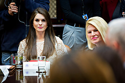 Hope Hicks, White House director of strategic communications, listens while meeting with women small business owners with U.S. President Donald Trump, not pictured, in the Roosevelt Room of the White House in Washington, D.C., U.S., on Monday, March 27, 2017. Investors on Monday further unwound trades initiated in November resting on the idea that the election of Trump and a Republican Congress meant smooth passage of an agenda that featured business-friendly tax cuts and regulatory changes. Photographer: Andrew Harrer/Bloomberg