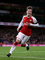 """Arsenal's Mesut Ozil celebrates scoring his side's fourth goal of the game during the Premier League match at the Emirates Stadium, London. PRESS ASSOCIATION Photo. Picture date: Wednesday November 29, 2017. See PA story SOCCER Arsenal. Photo credit should read: Nigel French/PA Wire. RESTRICTIONS: EDITORIAL USE ONLY No use with unauthorised audio, video, data, fixture lists, club/league logos or """"live"""" services. Online in-match use limited to 75 images, no video emulation. No use in betting, games or single club/league/player publications"""