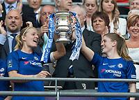 Football - SSE Women's FA Cup Final - Arsenal Women vs. Chelsea Ladies<br /> <br /> Katie Chapman (Chelsea Ladies FC) and Maren Mjelde (Chelsea Ladies FC) lift the trophy at Wembley Stadium.<br /> <br /> COLORSPORT/DANIEL BEARHAM