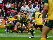 Australia scrum-half James Tuttle throws a pass to fly-half Mack Mason during the World Rugby U20 Championship  match England U20 -V- Australia U20 at The AJ Bell Stadium, Salford, Greater Manchester, England on June  15  2016, (Steve Flynn/Image of Sport)