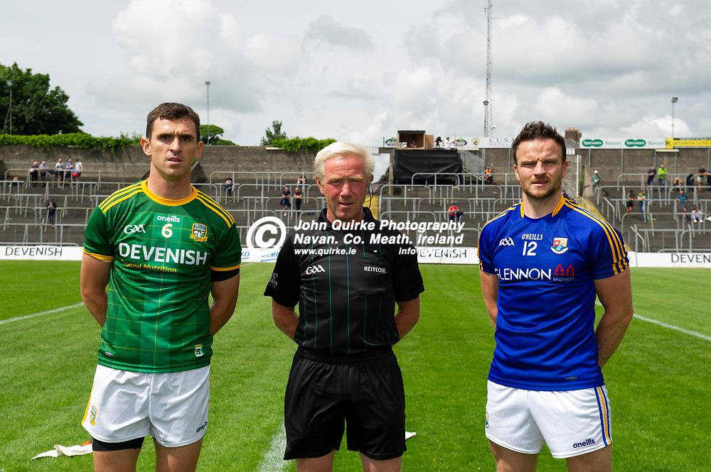 04-07-21. Meath v Longford - Leinster SFC Quarter-Final at Pairc Tailteann, Navan.<br /> Meath captain Shane McEntee and Longford captain Donal McElligott with referee Ciaran Branagan, Down.<br /> Photo: John Quirke / www.quirke.ie<br /> ©John Quirke Photography, 16 Proudstown Road, Navan. Co. Meath. (info@quirke.ie / 046-9028461 / 087-2579454).