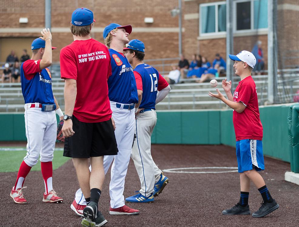 Grayson Gilbert, 11, tosses a ball while visiting the Post 1 Omaha, Nebraska, legion baseball team. Post 1 Omaha, Nebraska, played Post 307 Renner, South Dakota, in a legion baseball game at Creighton Prep on Wednesday, June 20, 2018, in Omaha, Nebraska.