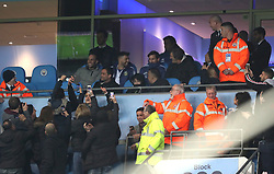 Fans in the stands take photos of Lionel Messi and Sergio Aguero as stewards attempt to stop them during the international friendly match at the Etihad Stadium, Manchester.