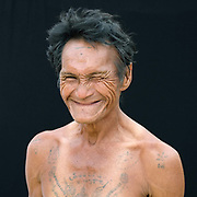 Portrait of a Karen Pwo ethnic minority man with traditional tattoos at Mae Lay village, Chiang Mai province, Thailand