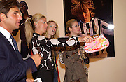 George Veroni, ( ?) Tamara Beckwith, Georgia Graham and Anouskha Beckwith, Fifa 100 private view, Exhibition of photographs of the 125 greatest living players.  Royal Academy, 1 June 2004. ONE TIME USE ONLY - DO NOT ARCHIVE  © Copyright Photograph by Dafydd Jones 66 Stockwell Park Rd. London SW9 0DA Tel 020 7733 0108 www.dafjones.com