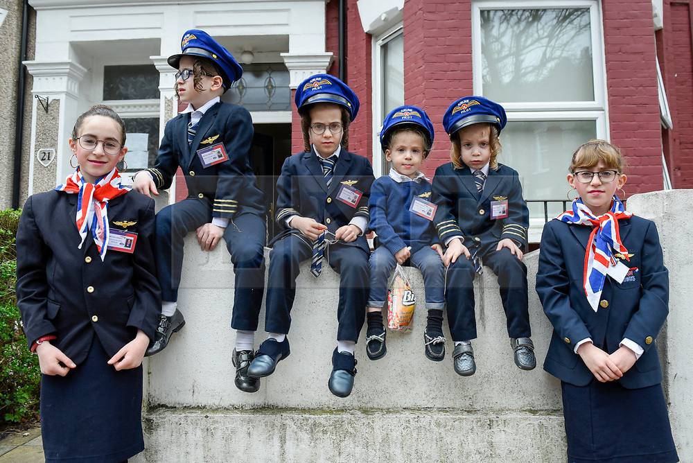 © Licensed to London News Pictures. 21/03/2019. LONDON, UK.  Children in Stamford Hill, north London, dress in colourful costumes as they celebrate the Jewish festival of Purim.  The festival involves the reading of the Book of Esther, describing the defeat of Haman, the Persian king's adviser, who plotted to massacre the Jewish people 2,500 years ago, an event that was prevented by Esther's courage. [Parental consent to photograph obtained]  Photo credit: Stephen Chung/LNP