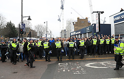 Fans surrounded by police prior to the match