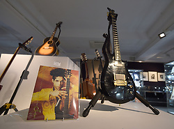 A guitar owned by Prince (front right) and a guitar owned by Jimi Hendrix (back left) on display ahead of the the Entertainment Memorabilia Sale at Bonhams in Knightsbridge, London later this week.