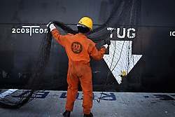 """Indian seafarers help to dock the MSC Ingrid, which was at port in Limassol, Cyprus on Feb. 22, 2008. Cyprus is the crossroads of international ship management and  where all the agencies are recruiting and hiring the cheapest workers worldwide. Cyprus is also one of the """"Flag-of-Convenience"""" States like Panama and Liberia."""