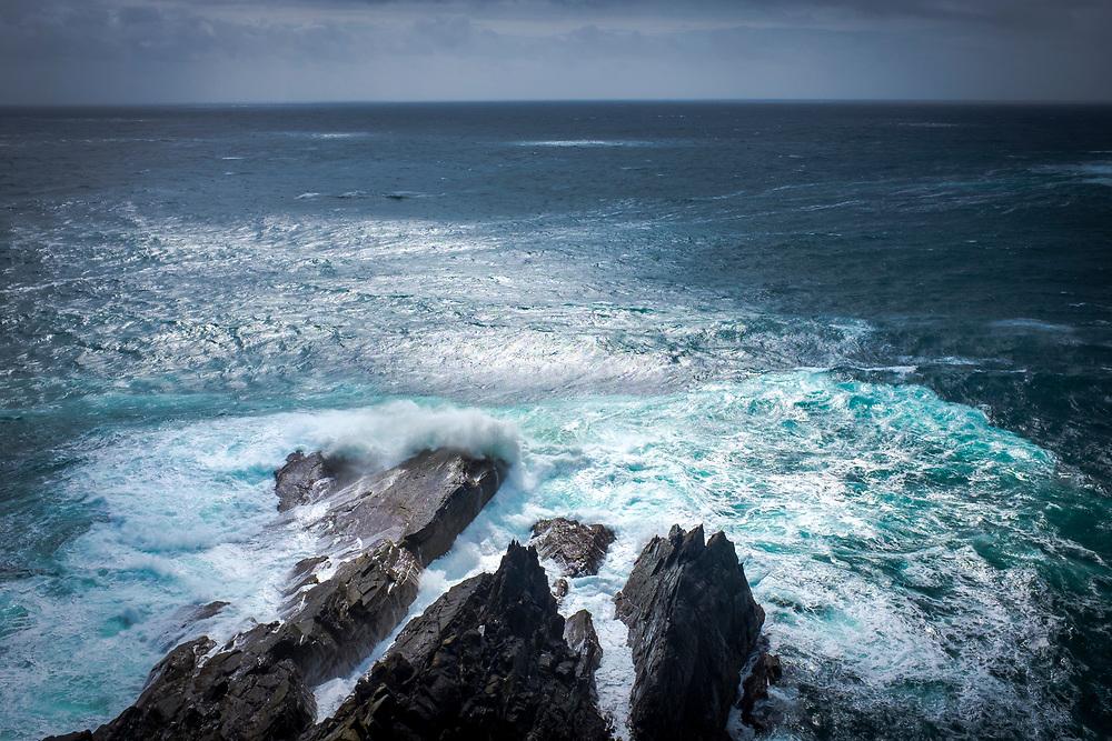 Atlantic Waves breaking on the rocky coast, at Mizen Head, Cork, Ireland