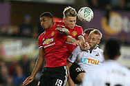Scott McTominay of Manchester Utd © heads the ball ahead of Marcus Rashford of Manchester Utd (l) and Mike van der Hoorn of Wswansea City (r). EFL Carabao Cup 4th round match, Swansea city v Manchester Utd at the Liberty Stadium in Swansea, South Wales on Tuesday 24th October 2017.<br /> pic by  Andrew Orchard, Andrew Orchard sports photography.