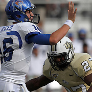 Memphis quarterback Taylor Reed (16) throws the ball before getting hit by Central Florida linebacker Jonathan Davis (27) during an NCAA football game between the Memphis Tigers and the Central Florida Knights at Bright House Networks Stadium on Saturday, October 29, 2011 in Orlando, Florida. (AP Photo/Alex Menendez)