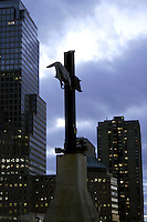 23 October 2005: A single steel cross from the remains of the World Trade Center in Lower Manhattan at Sunset surrounded by buildings.  Travel photos of tourist landmarks in Manhattan New York on a fall day. Part of an ongoing 9/11 Documentary Personal Project.