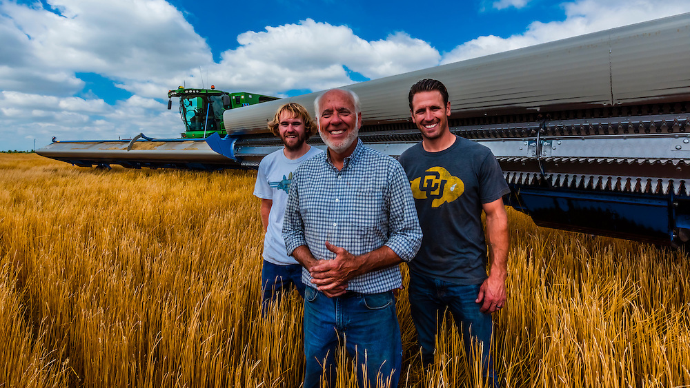 Farmers Gary Schields and his sons, Brett and Matt, with their combines during the wheat harvest, Schields & Sons Farming, Goodland, Kansas USA.