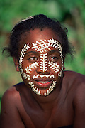 Local woman with sandalwood paste face decoration Madagascar Nosy Komba Island