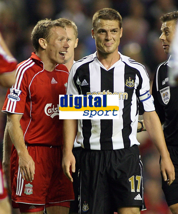 Photo: Paul Thomas.<br /> Liverpool v Newcastle United. The Barclays Premiership. 20/09/2006.<br /> <br /> Craig Bellamy (L) of Liverpool has words to Scott Parker after Parker won a penalty for Newcastle.
