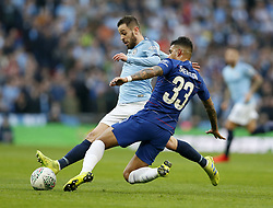 BRITAIN-LONDON-FOOTBALL-CARABAO CUP FINAL-CHELSEA VS MAN London.(190224) -- LONDON, Feb. 24, 2019  Manchester City's Bernardo Silva is tackled by Chelsea's Emerson during the Carabao Cup Final match between Chelsea and Manchester City at Wembley Stadium in London, Britain on Feb. 24, 2019. Manchester City won 4-3 on penalties after a 0-0 draw.  FOR EDITORIAL USE ONLY. NOT FOR SALE FOR MARKETING OR ADVERTISING CAMPAIGNS. NO USE WITH UNAUTHORIZED AUDIO, VIDEO, DATA, FIXTURE LISTS, CLUB/LEAGUE LOGOS OR ''LIVE'' SERVICES. ONLINE IN-MATCH USE LIMITED TO 45 IMAGES, NO VIDEO EMULATION. NO USE IN BETTING, GAMES OR SINGLE CLUB/LEAGUE/PLAYER PUBLICATIONS. (Credit Image: © Matthew Impey/Xinhua via ZUMA Wire)