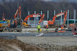 © Licensed to London News Pictures 26/12/2020.        Ashford, UK. Construction work on the site last week. The Ashford Lorry Park in Kent near junction 10a now has its official name on a sign at the entrance to the 66 acre site which is under construction. Sevington Inland Border Facility will have the capacity to hold 1700 freight vehicles in case of disruption at the Port of Dover. Photo credit:Grant Falvey/LNP