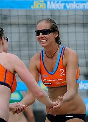 06-06-2010 VOLLEYBAL: JIBA GRAND SLAM BEACHVOLLEYBAL: AMSTERDAM<br /> In een koninklijke ambiance streden de nationale top, zowel de dames als de heren, om de eerste Grand Slam titel van het seizoen bij de Jiba Eredivisie Beach Volleyball - Charlotte Hermans<br /> ©2010-WWW.FOTOHOOGENDOORN.NL