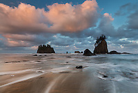 Sunrise ligths up of shore clouds on Olympic National Park's Second Beach, Washington
