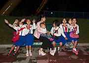 Fashion in North Korea<br /> <br /> In every corner of the earth, women love to look beautiful and keep up with the latest fashion trends. The women of North Korea are no different. Fashion is taken seriously here. But in North Korea, women do not read Elle or Vogue; they just glimpse a few styles by watching TV or by observing the few foreigners who come to visit. In the hermit kingdom, clothing also reflects social status. If you have foreign clothes it means you travel and are consequently close to the centralized power. Chinese products have inundated the country, adding some color to the traditional outfits that were made of vynalon fiber. But citizens beware, too much style means you're forgetting the North Korean juche, the ethos of self-reliance that the country is founded on! But the youth tend to neglect it despite the potential consequences.<br /> <br /> Photo shows: The mother here can be seen wearing some brand new shoes that could not be found just a few years ago in North Korea. These platform boots are Chinese and have started to change the way North Korean women look. They love to dress like this when they are on vacation or at amusement parks.<br /> ©Eric Lafforgue/Exclusivepix Media