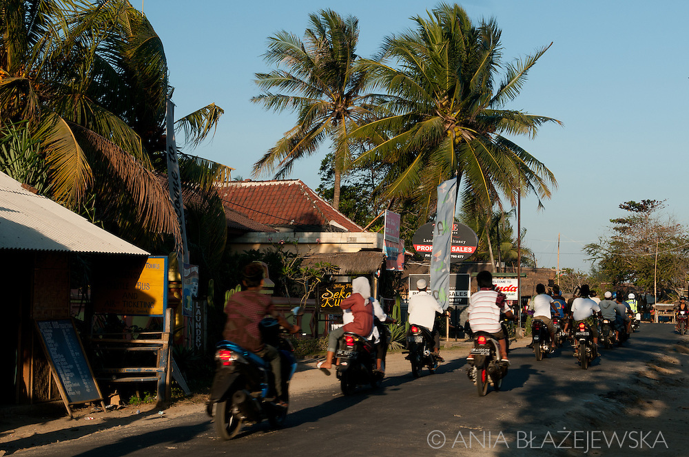Indonesia, Lombok. Motorbikes on the street in Kuta, probably going to the wedding.