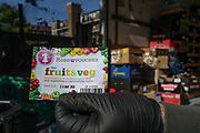"""A Kurdish local street market retailer shows voucher for fruit and veg worth of £1 collected from his customers in """"East Street Market"""" in Walworth, South London on Tuesday, May 5, 2020. Under a government scheme, families in need in England should receive vouchers worth £15 a week per child. Whilst a few European countries relax the COVID-19 lockdown, Britain still remains under lockdown without an exit strategy yet. (Photo/Vudi Xhymshiti)"""