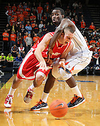Dec. 07, 2010; Charlottesville, VA, USA; Radford Highlanders guard Evan Faulkner (2) is fouled by Virginia Cavaliers guard K.T. Harrell (24) at the John Paul Jones Arena. Mandatory Credit: Andrew Shurtleff
