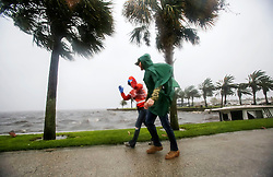 A couple walk along the Sanford Riverwalk along Lake Monroe as strong winds and rain continue from Hurricane Matthew in downtown Sanford on Friday, October 7, 2016. Photo byJacob Langston/Orlando Sentinel/TNS/ABACAPRESS.COM