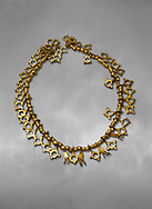 Bronze Age Hattian gold necklace from Grave TM, possibly a Bronze Age Royal grave (2500 BC to 2250 BC) - Alacahoyuk - Museum of Anatolian Civilisations, Ankara, Turkey .<br /> <br /> If you prefer to buy from our ALAMY PHOTO LIBRARY  Collection visit : https://www.alamy.com/portfolio/paul-williams-funkystock/royal-tombs-alaca-hoyuk-bronze-age.html (TIP refine search by adding background colour in the LOWER search box)<br /> <br /> Visit our ANCIENT WORLD PHOTO COLLECTIONS for more photos to download or buy as wall art prints https://funkystock.photoshelter.com/gallery-collection/Ancient-World-Art-Antiquities-Historic-Sites-Pictures-Images-of/C00006u26yqSkDOM