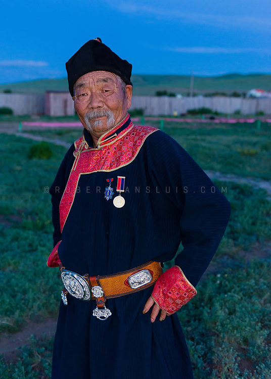 Portrait of an old man in traditional dress and medals in Kharkhorin, Mongolia. Photo ©robertvansluis.com