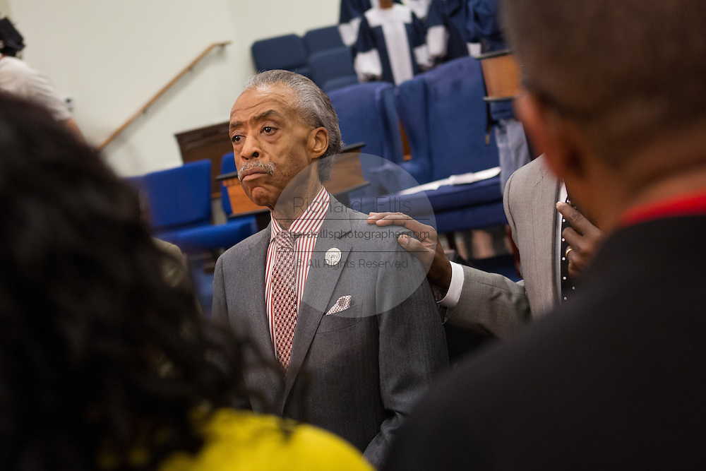 Rev. Al Sharpton prays with worshippers following his address to a healing service at Charity Missionary Baptist Church April 12, 2015 in North Charleston, South Carolina. Sharpton spoke following the recent fatal shooting of unarmed motorist Walter Scott police and thanked the Mayor and Police Chief for doing the right thing in charging the officer with murder.
