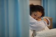WUHAN, CHINA - APRIL 02: (CHINA OUT) <br /> <br /> 7-year-old Boy Donates Kidney To His Mother After he Died<br /> <br />  Zhou Lu waits in the ward after talking with doctor at 6:30 a.m which her 7-year-old son died at 4:15 a.m. on April 2, 2014, in Wuhan, Hubei Province of China. Chen Xiaotian, a 7-year-old boy died from malignant brain tumors at 4 a.m. on April 02, 2014. He donated his left kidney to his mother Zhou Lu who suffered from uremia and can only cured by a kidney transplant. Chen was diagnosed with malignant brain tumor when he was five-and-a-half years old and has lost his vision in both eyes early this year due to the exacerbation of his brain tumors. Chen also donated his right kidney to a 21-year-old woman and his liver to a 27-year-old man. The operation was both completed on Wednesday.<br /> ©Exclusivepix