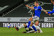 Mike the Wierik of Derby County (6)  in a tackle with Cardiff City midfielder Joe Ralls (8) during the EFL Sky Bet Championship match between Derby County and Cardiff City at the Pride Park, Derby, England on 28 October 2020.