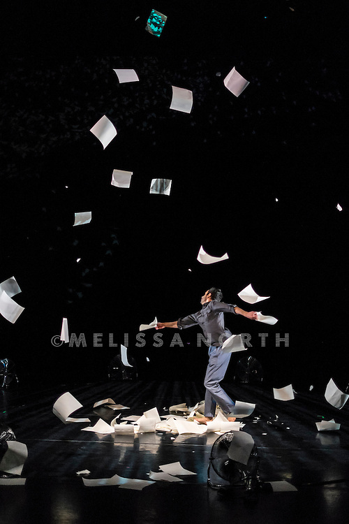 Aakash Odedra performs Murmur at a press photocall at The Linbury Studio Theatre, Royal Opera House, London, UK, on 23rd January 2015. Diagnosed with early dyslexia, Murmur (a collaboration between Aakash Odedra and Lewis Major) is the imaginative expression of both Odedra's frustration with words and his liberation through dance and performance. Creative collaborators Ars Electronica Futurelab animate Odedra's stage world with three-dimensional light and projection while a circle of electric fans create a vortex of swirling paper.
