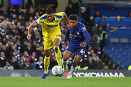 AFC Wimbledon striker Jake Jervis (10) taking on Faustino Anjorin of Chelsea (64) during the EFL Trophy match between U21 Chelsea and AFC Wimbledon at Stamford Bridge, London, England on 4 December 2018.