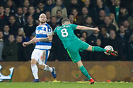 Watford midfielder Tom Cleverley (8) shoots at goal during The FA Cup 5th round match between Queens Park Rangers and Watford at the Loftus Road Stadium, London, England on 15 February 2019.