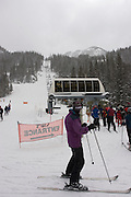 Vertical of skiers waiting for chairlift