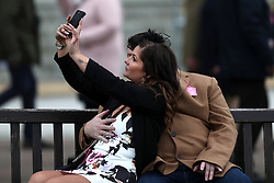 Racegoers take a self portrait during Ladies Day of the 2018 Cheltenham Festival at Cheltenham Racecourse. PRESS ASSOCIATION Photo. Picture date: Wednesday March 14, 2018. See PA story RACING Cheltenham. Photo credit should read: David Davies/PA Wire. RESTRICTIONS: Editorial Use only, commercial use is subject to prior permission from The Jockey Club/Cheltenham Racecourse.