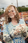 A competitor smiles after rolling around in a pool of instant grits during the grits roll competition at the World Grits Festival April 14, 2012 in St. George, SC. The festival celebrates the southern love for the sticky corn porridge