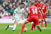 Real Madrid's Marco Asensio (l) and Sevilla FC's Guido Pizarro during La Liga match.December 09,2017. (ALTERPHOTOS/Acero)