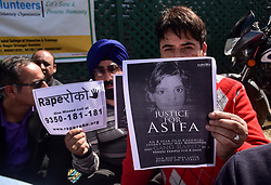 April 13, 2018 - Srinagar, J&K, India - Kashmiri residents take part in a protest demanding capital punishment for the accused involved in rape and murder of 8-year-old Asifa Bano in Srinagar, Indian administered Kashmir. Asifa was abducted and gang-raped for over a week before she was stoned to death by her captors in January in Jammu's Kathua district. (Credit Image: © Saqib Majeed/SOPA Images via ZUMA Wire)