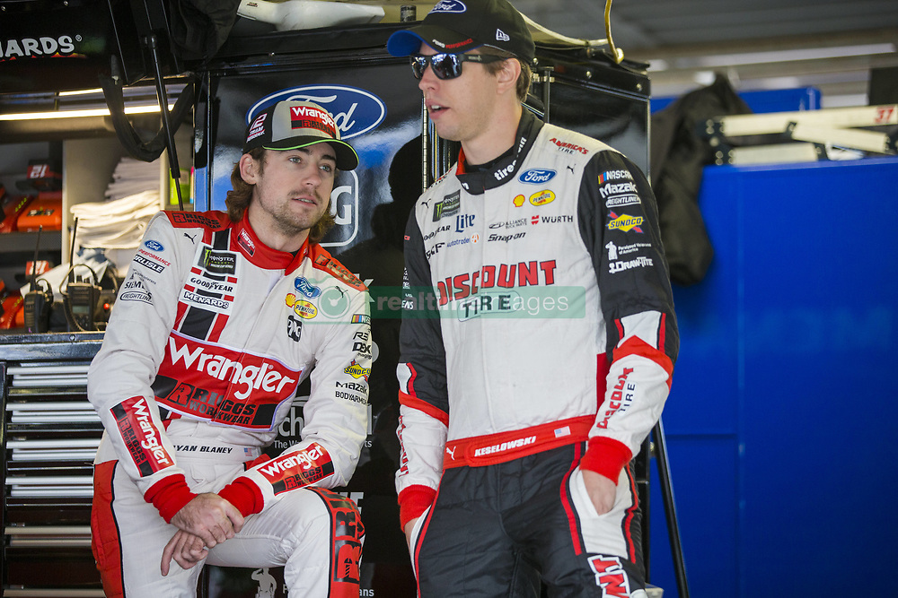 October 19, 2018 - Kansas City, Kansas, United States of America - Ryan Blaney (12) and Brad Keselowski (2) hang out in the garage during practice for the Hollywood Casino 400 at Kansas Speedway in Kansas City, Kansas. (Credit Image: © Justin R. Noe Asp Inc/ASP via ZUMA Wire)