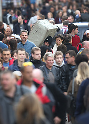 © Licensed to London News Pictures. 19/12/2015. London, UK. A man carries a box through a busy Oxford Street on the last Saturday before Christmas. Photo credit: Peter Macdiarmid/LNP
