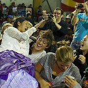 Yolanda La Amorosa seeks help from the tourists in the crowd as her male Counterpart moves in to attack her with a plastic bottle during the 'Titans of the Ring' wrestling group's Sunday performance at El Alto's Multifunctional Centre. Bolivia. The wrestling group includes the fighting Cholitas, a group of Indigenous Female Lucha Libra wrestlers who fight the men as well as each other for just a few dollars appearance money. El Alto, Bolivia, 11th April 2010. Photo Tim Clayton