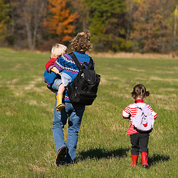 A woman and her young children explore a field on the Common Pasture in Newburyport, MA. MR